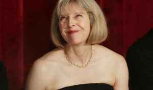 Theresa May, Home Secretary, smiling and happy of her work for immigration this year?
