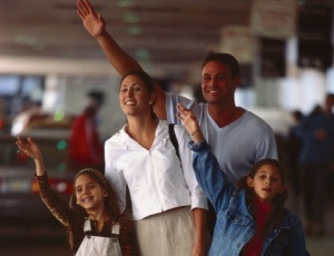 Family waiting their loved ones at the airport