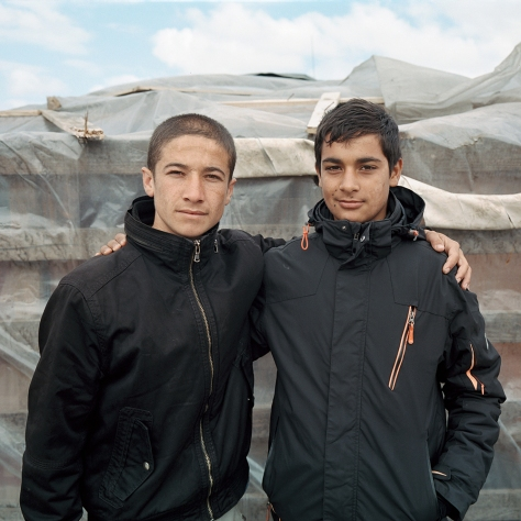 Calais Refugees Afghani Brothers holding